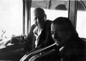 Stan Kenton and Francois Glorieux sitting in a tourbus.